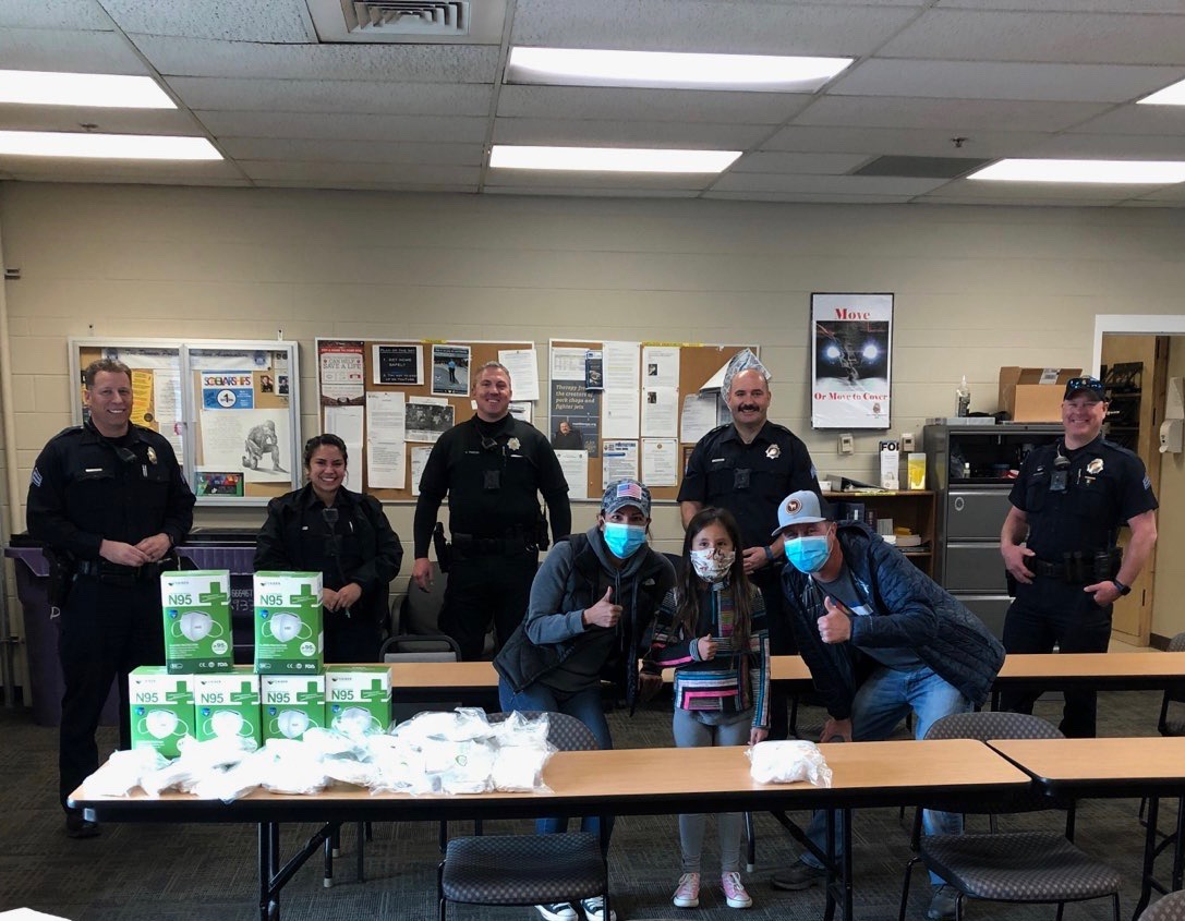 Daigle Family donating N95 Masks at Denver PD