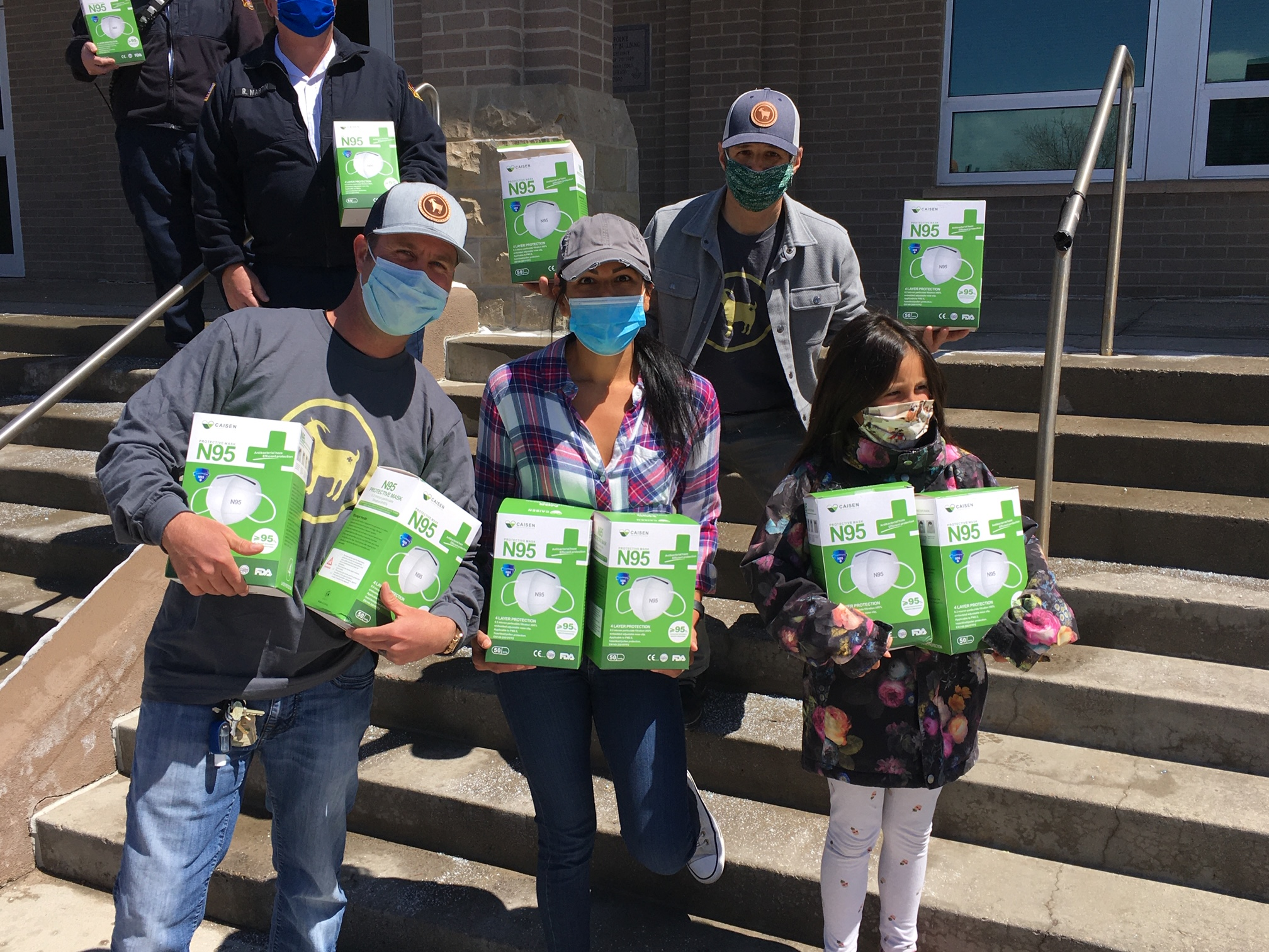 Daigle Family holding N95 Masks donated to Castle Rock PD